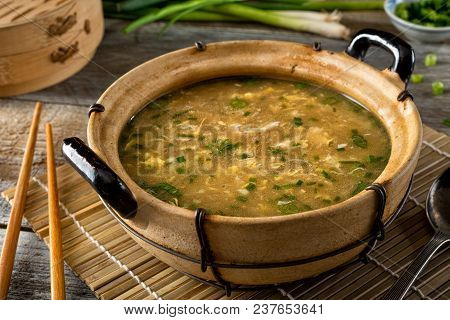 A Bowl Of Delicious Egg Drop Soup With Green Onion Garnish.