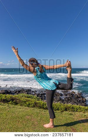 Practicing Yoga On The Scenic Island Of Maui