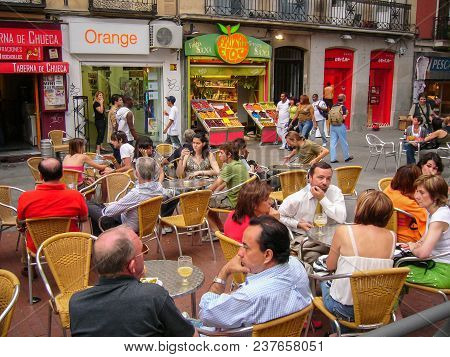 Madrid-june,8: People Sitting At Tables Of Street Cafe On The Square