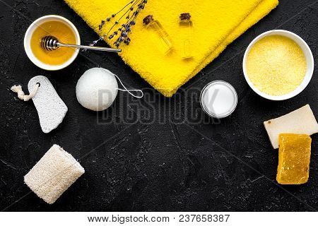 Honey Spa Set With Natural Honey, Soap, Cream, Towel And Pumice Stone On Black Background Top View.