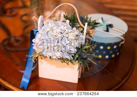 Nature, Arrangement, Handcraft Concept. There Is A Still Life Composed Of Wooden Ornamental Flowerpo