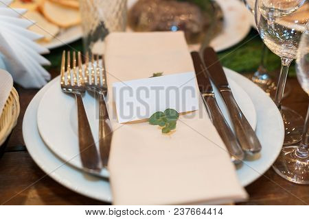 Nature, Catering, Dining Concept. Close Up Of Such Silverware As Forks And Knives Placed On The Whit