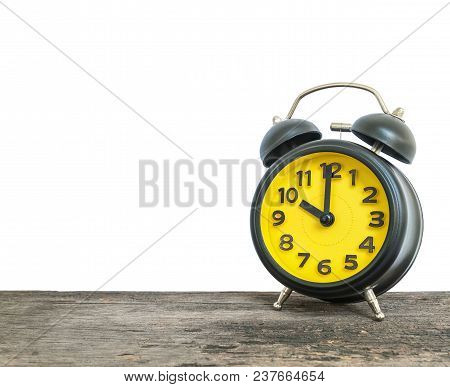 Closeup Alarm Clock For Decorate In 10 O'clock On Old Wood Desk Isolated On White Background With Co