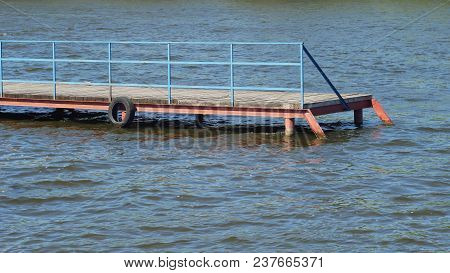 Old Wooden Pier At The Water Reservoir In A Fine Spring Sunny Day