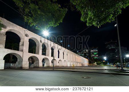 Famous Lapa Arches, Also Known As Carioca Aqueduct, At Night In Rio De Janeiro, Brazil