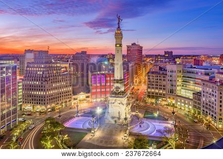 Indianapolis, Indiana, USA downtown cityscape over Monument Circle at dusk.