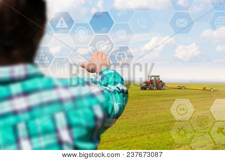 Farmer Manages Planting On The Virtual Screen. The Concept Of A New Technology In Agriculture.