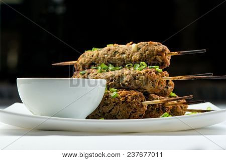 Kebab Lula With Herbs On White Plate With Ketchup