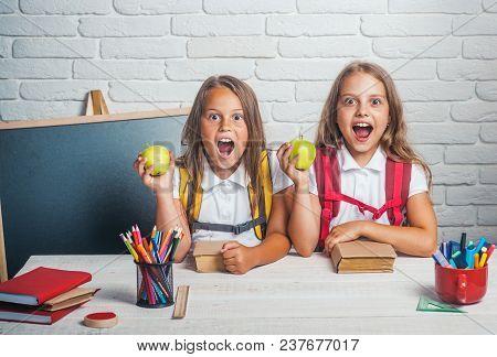 Happy School Kids At Lesson In September 1. Little Girls Eat Apple At Lunch Break. School Time Of Gi