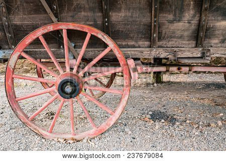 Old Red Wooden Wagon Wheel On A Conestoga Wagon