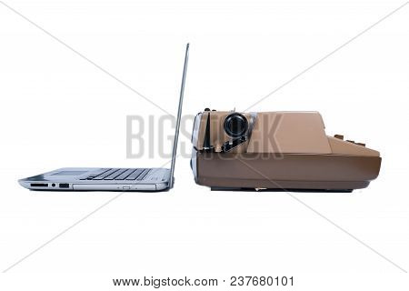 Old Typewriter Contracted Next To A New Laptop Computer