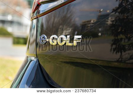 Dresden, Germany - April 2 2018: Volkswagen E-golf Plug-in Hybrid Electric Car Stands By Charging St