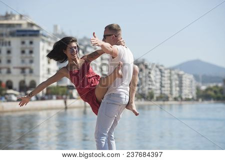 Happy Family Spend Time Together, Dancing, Having Fun, Sea And Urban Background. Couple In Love Stan