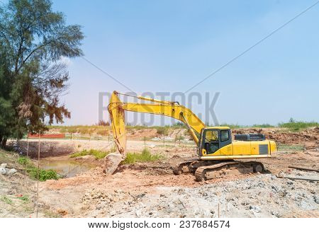 Heavy earth mover with blue sky in the background