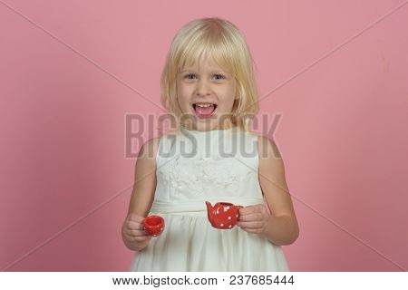 Tea Mood Of Happy Girl. Punchy Pastel Trend. Little Girl On Pink Background. Child Smile With Toy Te