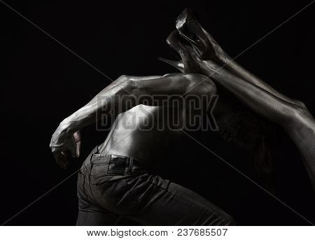 Henpecked Concept. Sexy Guy And Female Legs With High Heels. Man With Nude Torso Covered With Silver