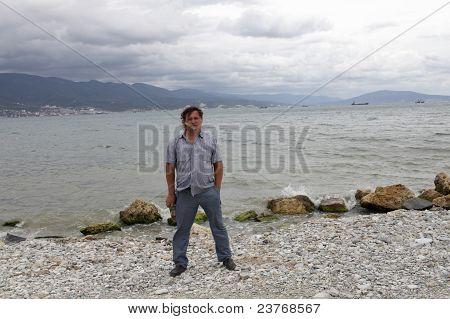Man Posing On Black Sea Background