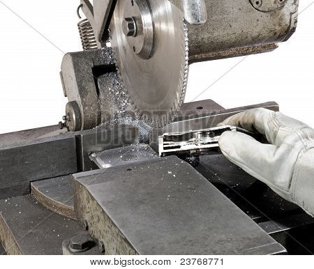 fresh sliced hard drive before circular saw in white background. Hand holding the drive. poster