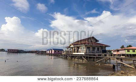 View Of Water Village Known As Patau Patau In Labuan Pearl Of Borneo,,malaysia With Sky Blue Backgro