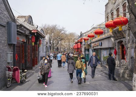 Beijing, China - Mar 20, 2018: People Visiting A Traditional Hutong In Beijing. Hutong Is An Alley I