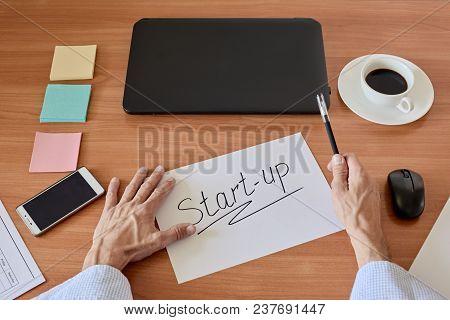 Businessman Hands Writing Text Start-up On Paper Sheet