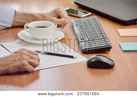 Closeup Photo Of Businessman Working With Documents In Modern Office