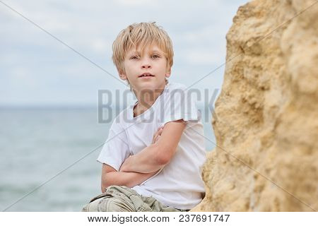 Portrait Of Happy Young Boy Having Fun At The Seaside