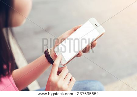 Photo Of A Woman Holding A Blank Screen Phone. Film Effect. Concept Technology And Modernization.