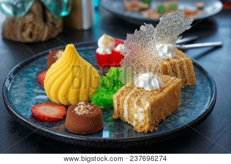 Desserts on marble plate, close-up