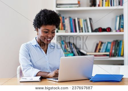 African American Businesswoman Working With Computer At Office At Home