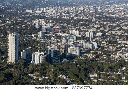 West Hollywood, California, USA - April 18, 2018:  Aerial view of towers and buildings along the Sunset Strip with downtown Hollywood in background.