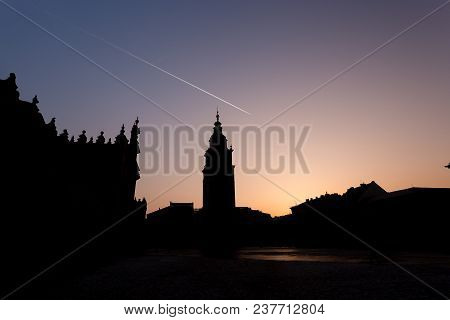 Silhouette Of Townhall Clocktower In Market Square During Beautiful Coloured Sunset, Krakow, Poland.