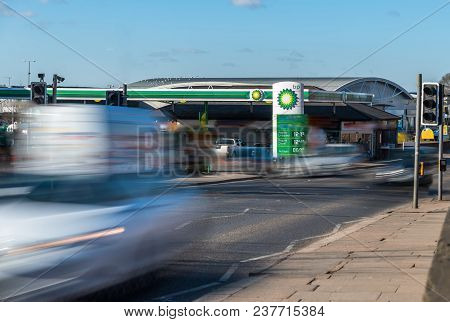 Northampton, Uk - Feb 26, 2018: Day View Of British Petroleum Bp Logo With Traffic In Motion Blur In