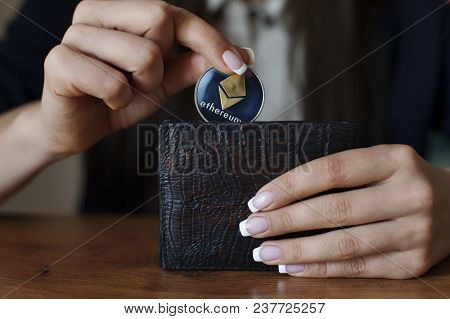 Successfully Woman Put An Ethereum Into Wallet. Eth Crypto Coin Saving. Savings Money. Blockchain Te