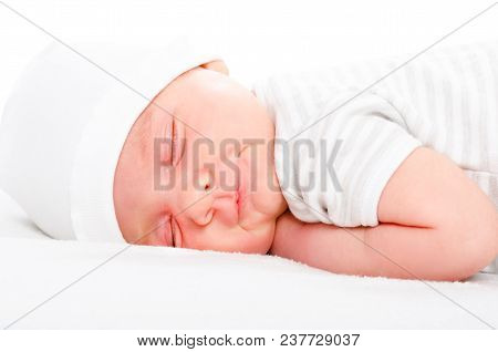 Portrait Of A Smiling Newborn Sleeping Baby Isolated On A White Background
