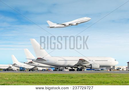 Passenger Aircraft Row, Airplane Parked On Service Before Departure At The Airport, Other Plane Push