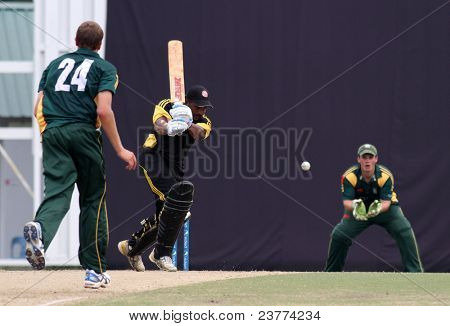 PUCHONG, MALAYSIA- SEPT 24: Tom Kimber, wicket-keeper of Guernsey catches Malaysia's R. Madhavan's hit at the Pepsi ICC WCL Div 6 finals at the Kinrara Oval on September 24, 2011 in Puchong, Malaysia.