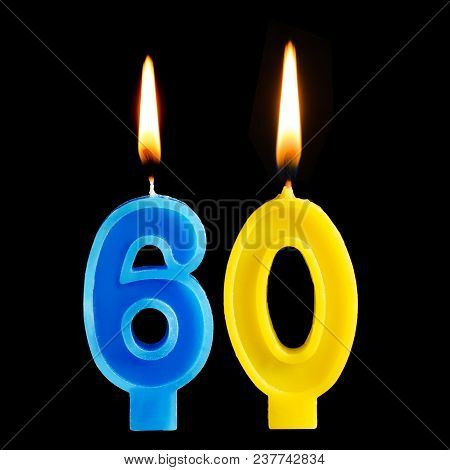 Burning Birthday Candles In The Form Of 60 Sixty Figures For Cake Isolated On Black Background. The