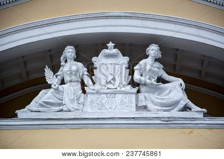 Sculptures On Facade Of Republican Trade Union Palace Of Culture. Soviet Architectural Style. Social