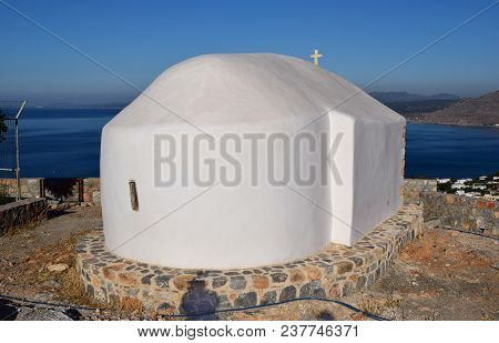 Greek Chapel. Prophet Elias Churc. A Small Chapel On A Hillside Next To The Villages Of Pefkos And L