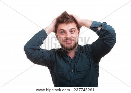 Cool Looking Young Man Puts His Hands On The Head Isolated Over White Background