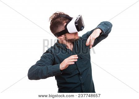 Young Man Experiencing Virtual Reality For The Firts Time. Isolated Over White Background. Studio Ph