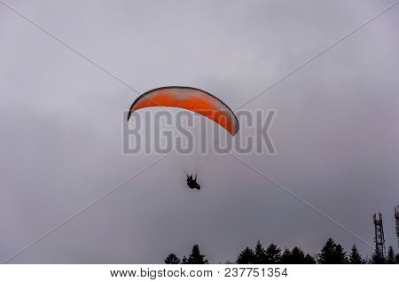 Image Of Parachute With Parachutist Skydiver In The Sky