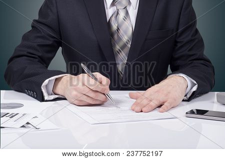 Business Documents On Office Table With Laptop Computer And Graph Financial Digital Diagram And Busi