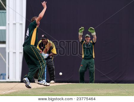 PUCHONG, MALAYSIA - SEPT 24: A. Martel and T. Kimber (green) of Guernsey signal to the umpire at the Pepsi ICC WCL Div 6 finals against Malaysia at the Kinrara Oval, Sept 24, 2011 in Puchong, Malaysia