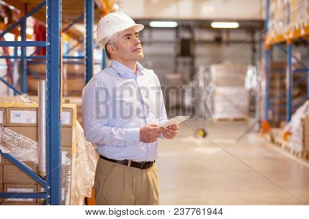 Logistics Manager. Smart Skilled Man Controlling The Work In The Warehouse While Being Logistics Man