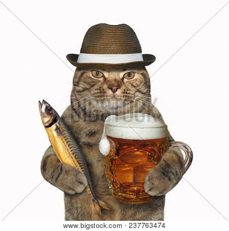 The Cat In Hat Holds A Glass Mug Of Beer And Smoked Mackerel. White Background.