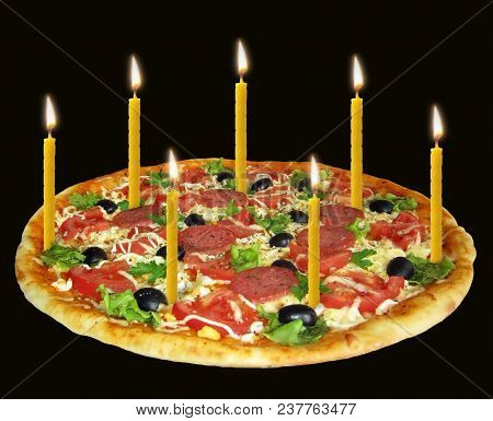 There Is A Holiday Pizza With Seven Burning Candles. Black Background.