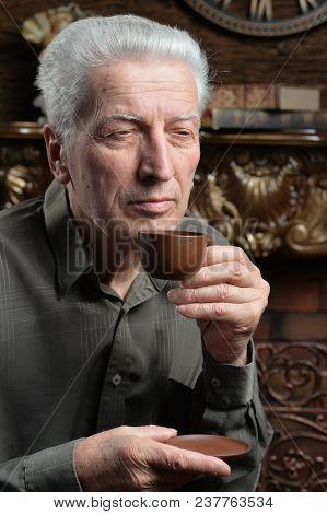 Portrait Of Senior Man Drinking Tea At Home