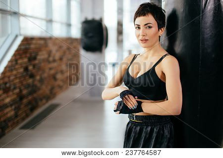 Young Caucasian Female Fixing Bandage At Sport Centure. Tight Bandage. Wrap Infirm Hand.